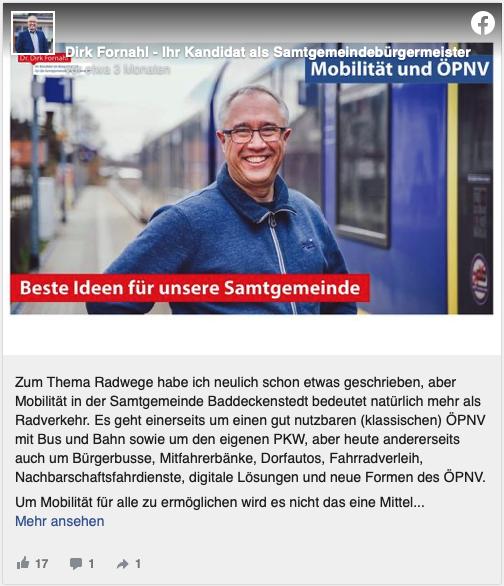Dirk Fornahl steht vor einem Zug am Bahnhof
